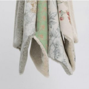 Grace Dog Blanket by Louisdog in 3 color combinations. Green cotton with a subtle pattern with beige fur, blue grey with a subtle pattern with khaki fur, and ivory with colorful flowers and beige fur
